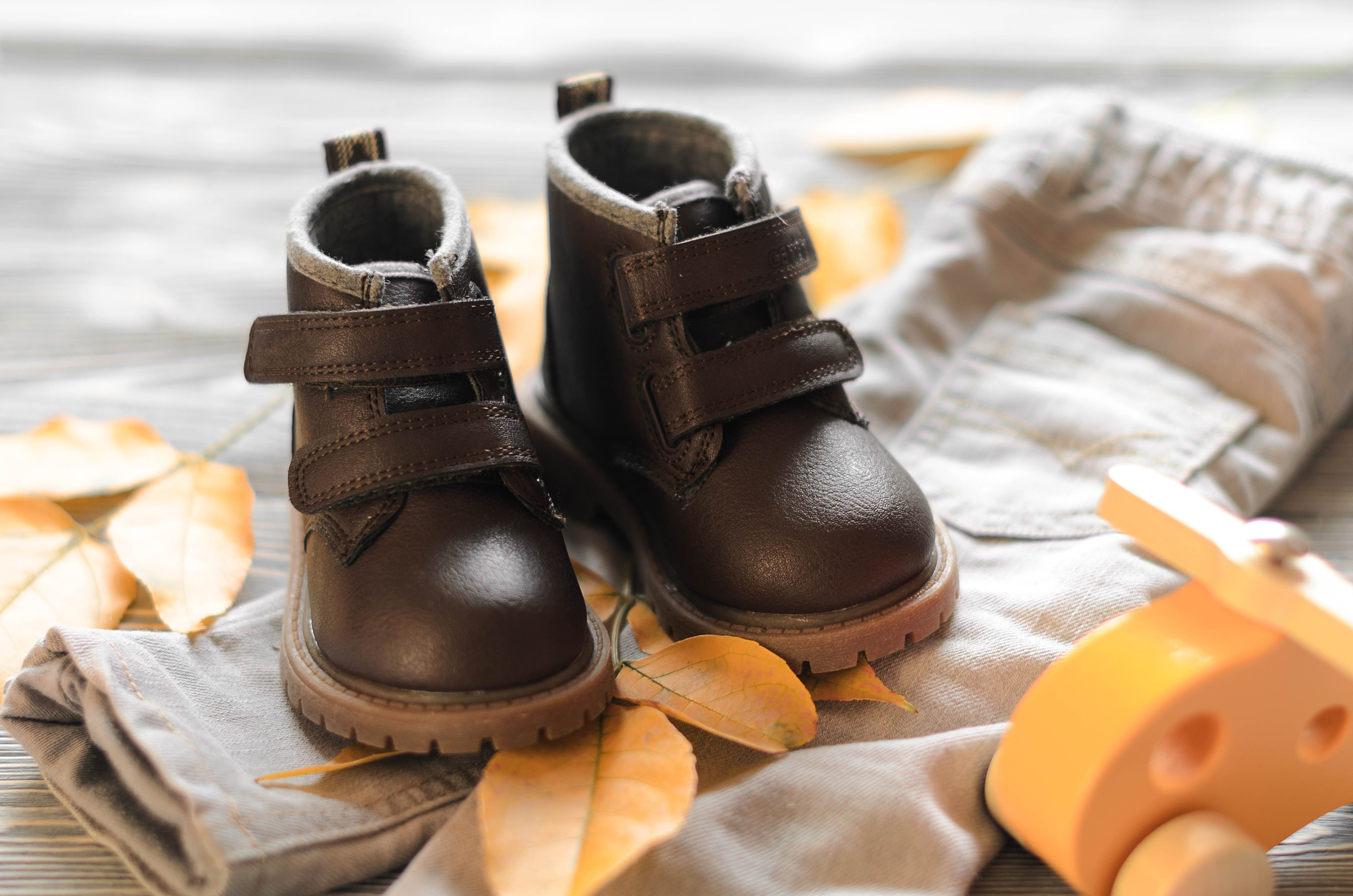 Father and son brown shoes on wooden background, fathers day